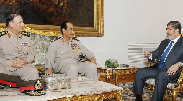 Then Egyptian president Mohamed Morsi (R) meeting with retired former defence minister Hussein Tantawi (C), and retired Armed Forces chief of staff, Sami Anan (L) at the presidential palace in Cairo on 14 August 2012 (AFP)
