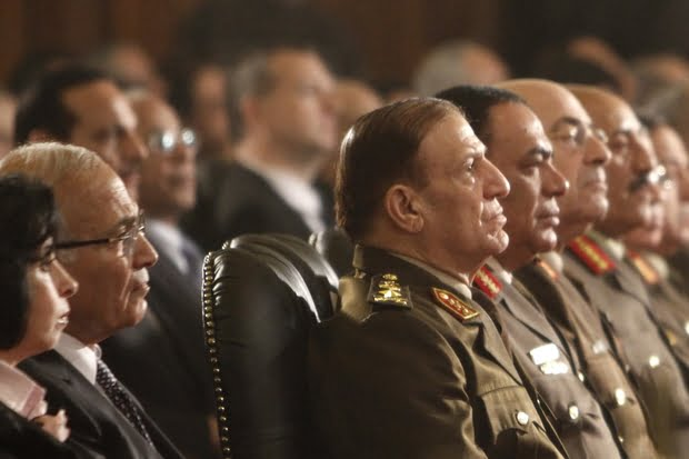 Then chief of staff of the Egyptian armed forces Sami Annan (3rd L) attends the Coptic Christmas midnight mass at Abbassiya Cathedral in Cairo on 6 January 2012 (AFP)