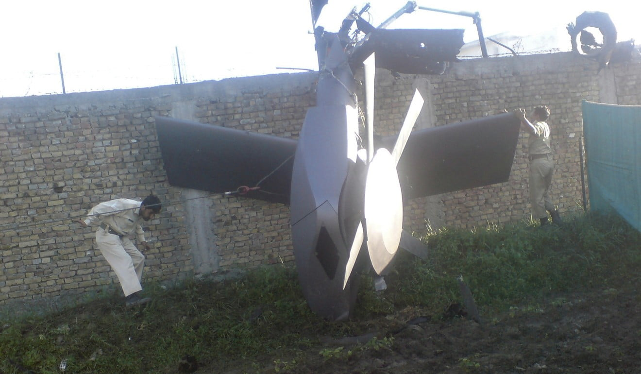 Part of a damaged US helicopter left at the scene of the Navy Seal raid on Osama bin Laden's compound in Abbottabad. Photo: Reuters