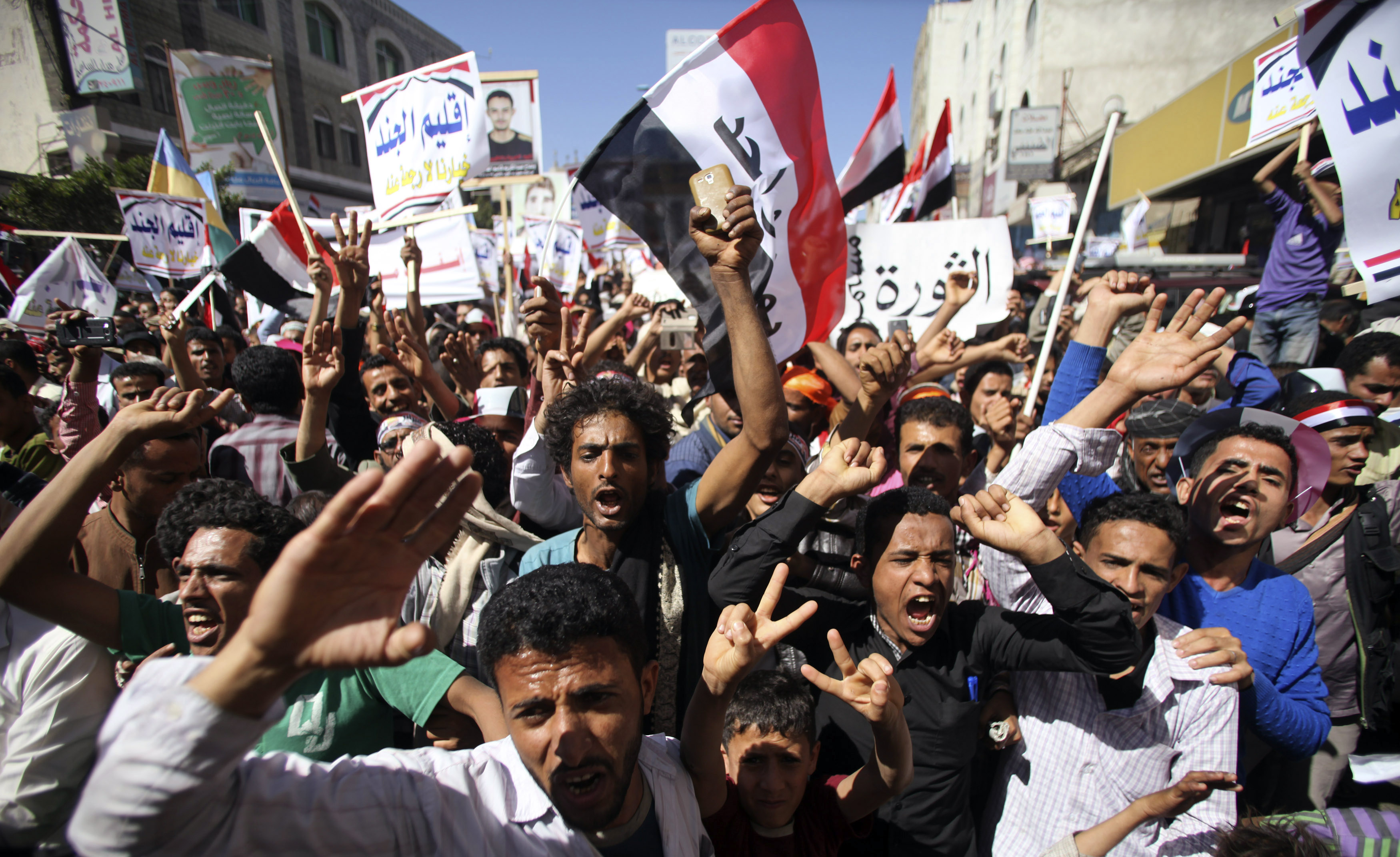 Anti-Houthi protesters shout slogans to commemorate the fourth anniversary of the uprising that toppled former president Saleh, in Taiz