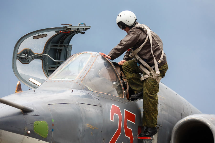 Russian pilot getting in a Russian Sukhoi Su-25 ground attack aircraft / AFP