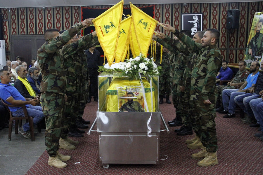 Mourners carry the coffin a fighter from Lebanon's Shiite Hezbollah movement who was killed near eastern border with war-ravaged Syria.