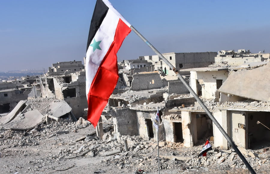 A general view shows destroyed buildings in Aleppo's Sheikh Saeed district / AFP / George Ourfalian