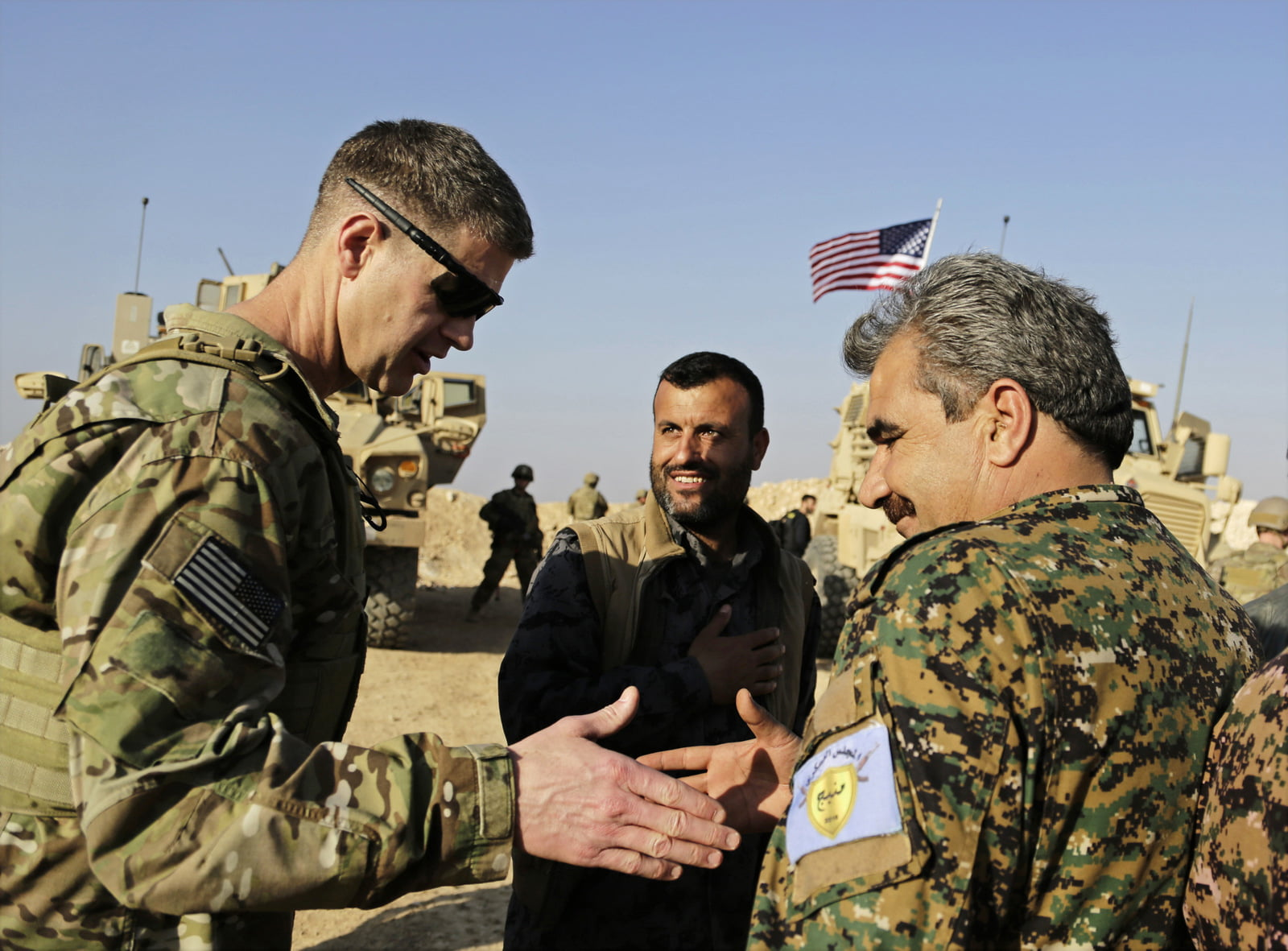U.S. Army Maj. Gen. Jamie Jarrard left, greets Manbij Military Council commander Muhammed Abu Adeel near the town of Manbij, in northern Syria, Feb. 7, 2018. (AP/Susannah George)