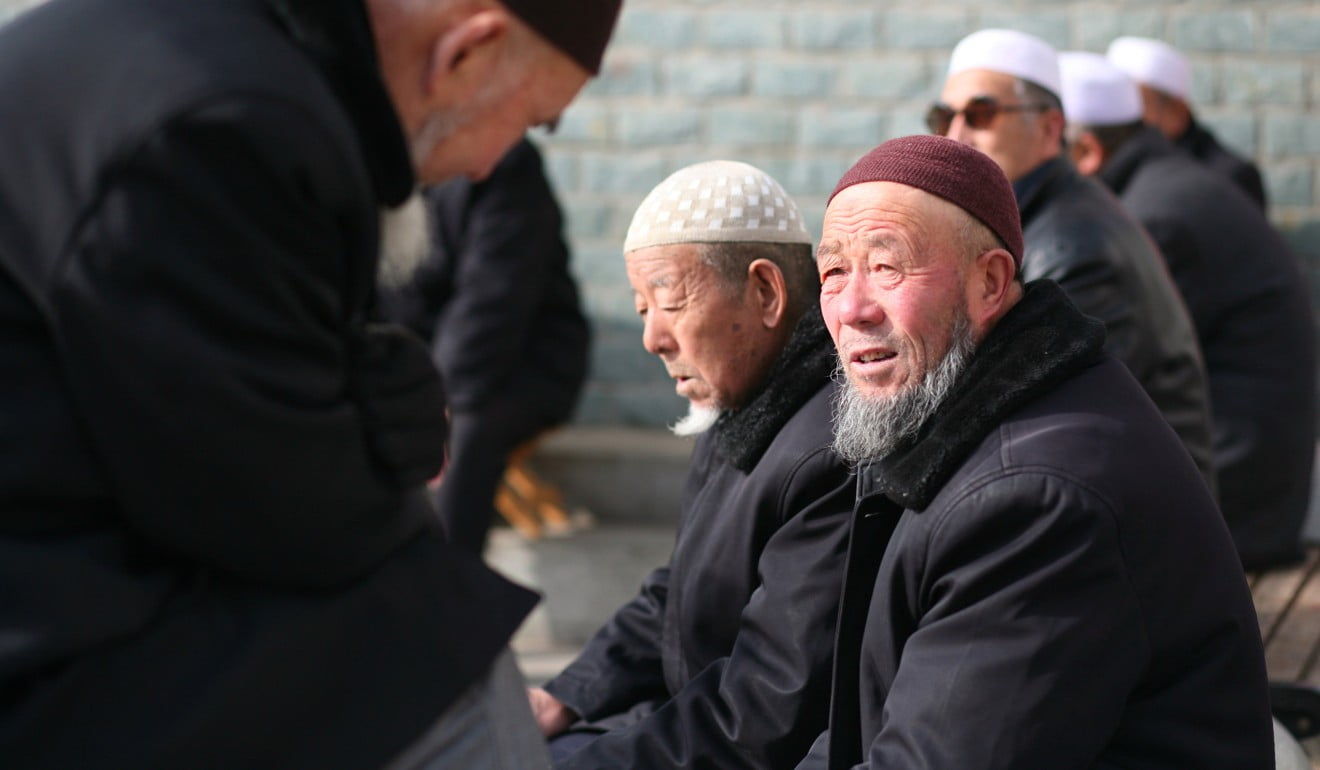 Men gather in a park in Linxia, Gansu province, home to a large population of ethnic minority Hui Muslims. Photo: Reuters