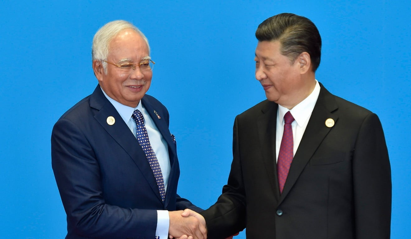Will Xi Jinping sweeten his demand to Malaysian Prime Minister Najib Razak for the return of 11 Uygur prisoners? Photo: AFP