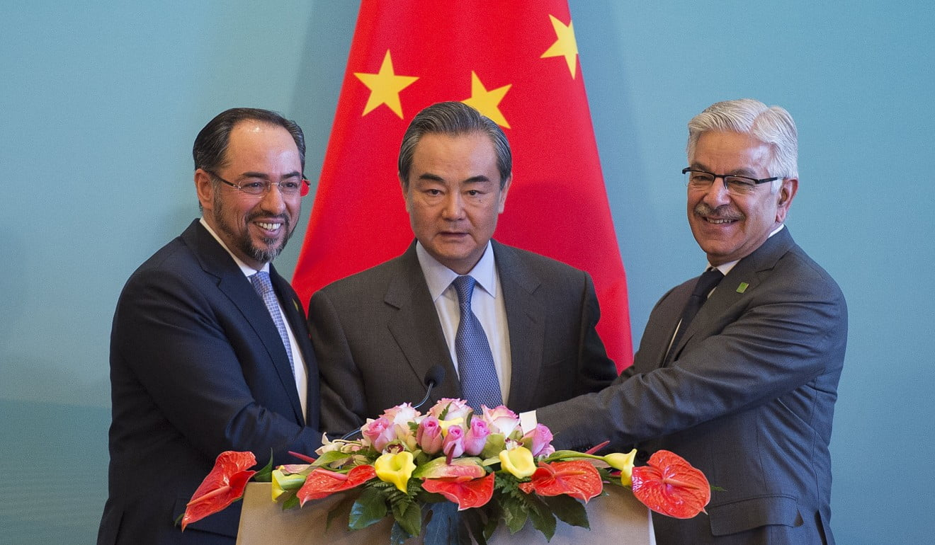 China's Foreign Minister Wang Yi, centre, Afghanistan's Foreign Minister Salahuddin Rabbani, left, and Pakistan's Foreign Minister Khawaja Muhammad Asif. Photo: AFP