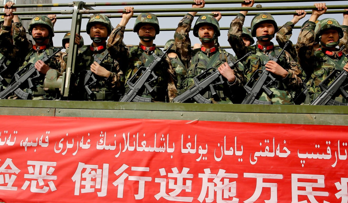 Chinese military police attend an anti-terrorist oath-taking rally in Hetian, Xinjiang. Photo: AFP