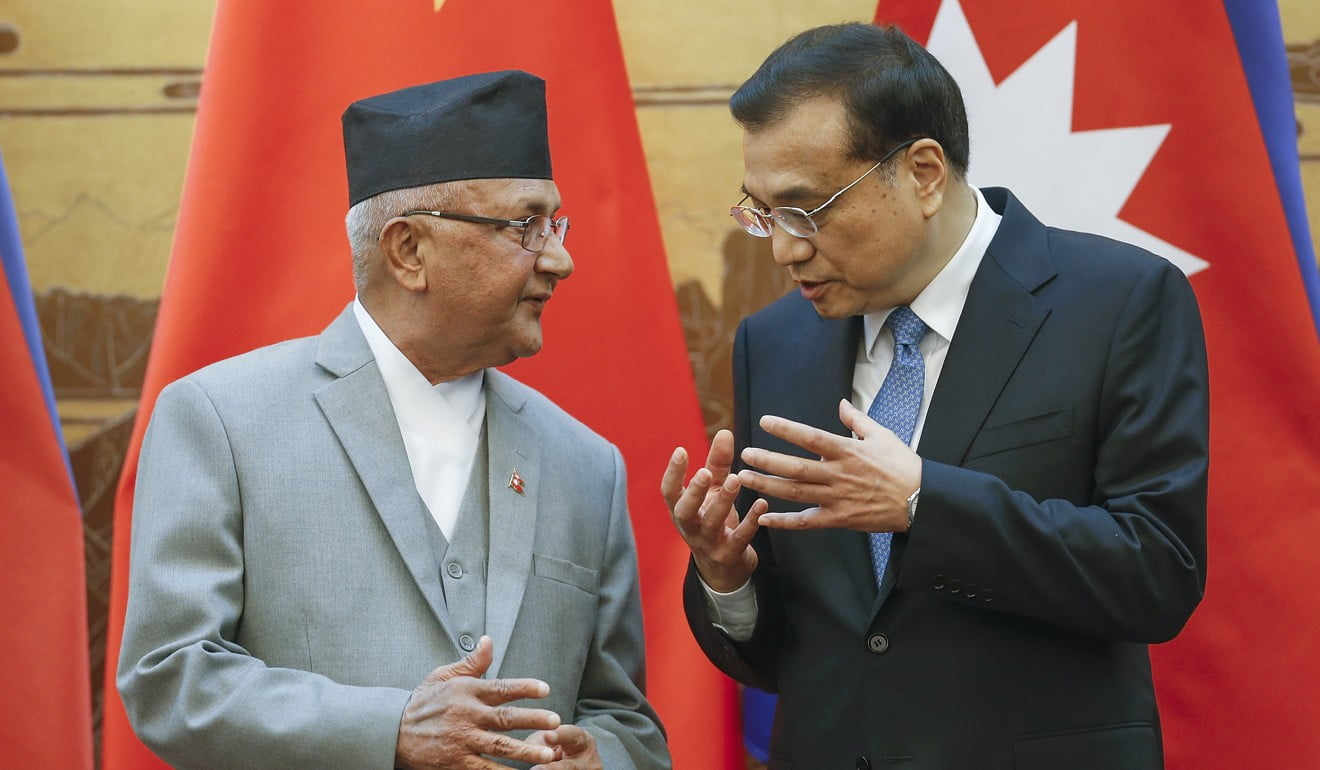 Premier Li Keqiang with Oli in March 2016, during Oli's first stint as Nepal's leader. Photo: AFP