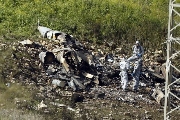 Remains of Israeli F-16 in northern Israeli Kibbutz of Harduf on Saturday 10 February 2018 (AFP)