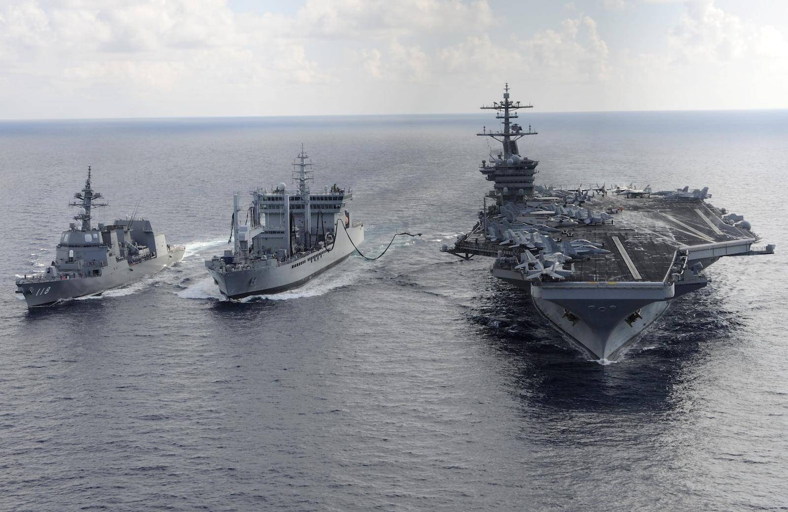 US aircraft carrier USS Theodore Roosevelt (R), Japanese Maritime Self-Defense Force Akizuki-class destroyer JS Fuyuzuki (L) and India's Deepak-class fleet tanker INS Shakti (C) during Exercise Malabar 2015. Photo: AFP/Handout/US Navy/ Chad M. Trudeau