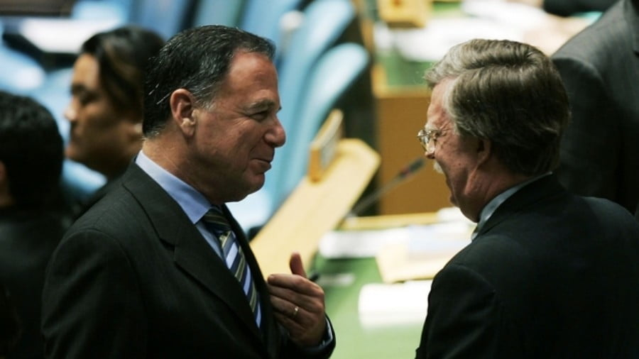 Dan Gillerman, Israel's ambassador to the UN (L), talks with John Bolton, the US ambassador to the UN, on the assembly floor during the United Nations General Assembly's 61st session on 12 September, 2006 in New York City (AFP)