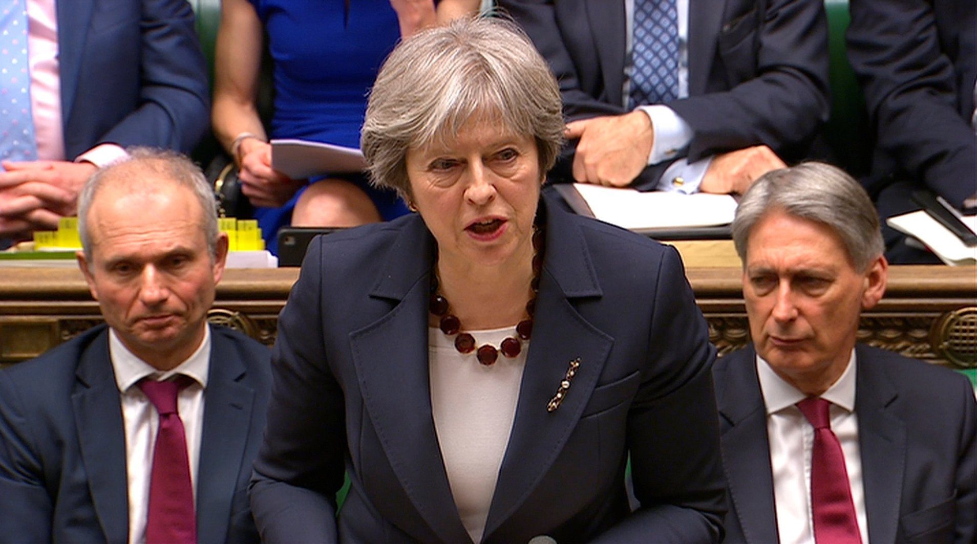 Britain's Prime Minister Theresa May addresses the House of Commons on her government's reaction to the poisoning of former Russian intelligence officer Sergei Skripal and his daughter Yulia in Salisbury, in London, March 14, 2018.  © REUTERS/ Parliament TV