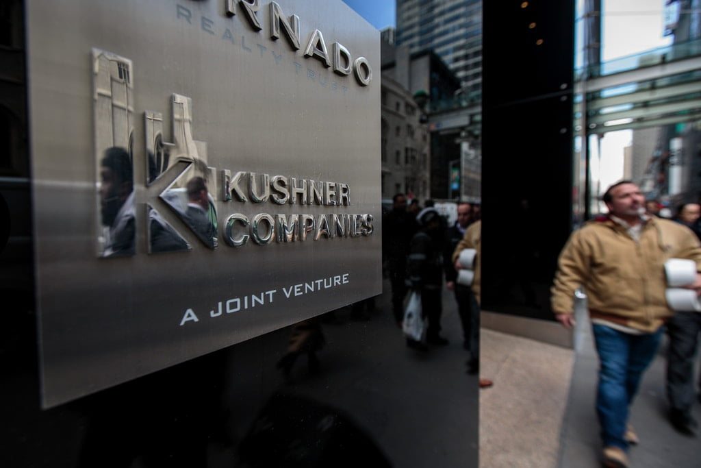 A Kushner Companies logo is visible near an entrance to the Kushner Companies' flagship property 666 Fifth Avenue in Midtown Manhattan, March 6, 2018, in New York City. Photo: Drew Angerer/Getty Images