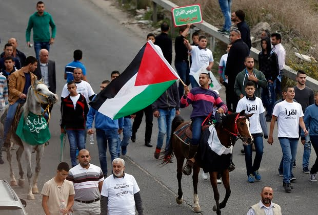 Palestinians take to the unnamed streets of Umm al-Fahm during a 2015 protest over the banning by Israel of the Islamic Movement (AFP)