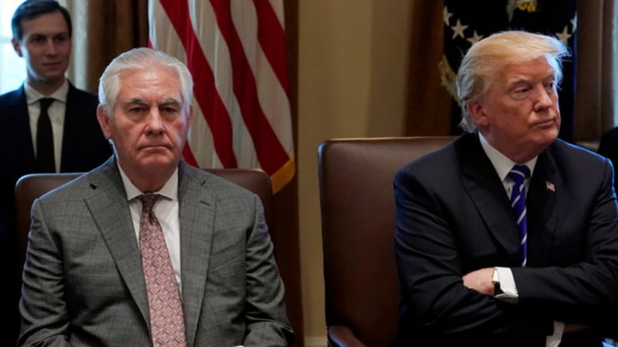 Tillerson, flanked here by Jared Kushner, was perceived as a calming influence on Trump (Reuters)