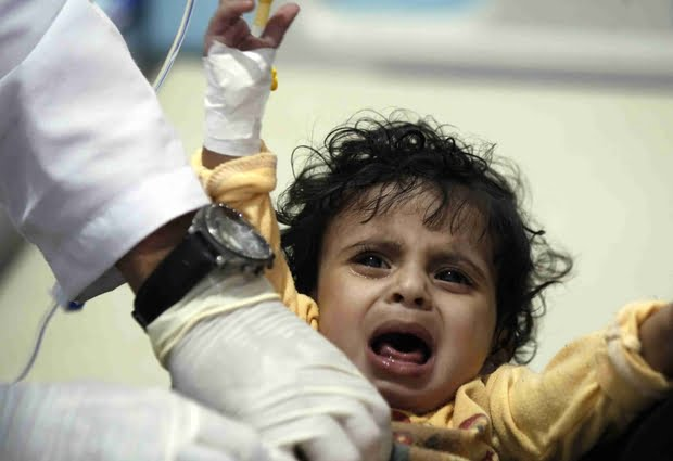 Yemeni child suspected of being infected with cholera receives treatment at a hospital in Sanaa on 15 May 2017 (AFP)