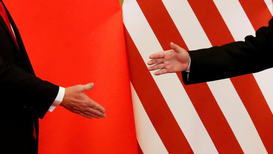 FILE PHOTO: U.S. President Donald Trump and China's President Xi Jinping shake hands after making joint statements at the Great Hall of the People in Beijing, China, November 9, 2017 © Damir Sagolj / Reuters