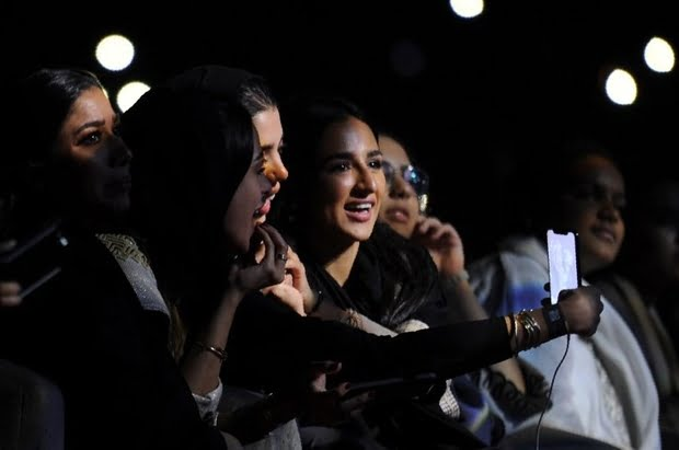 Saudi women take a selfie as they watch Egyptian pop star Tamer Hosny perform in Jeddah (AFP)