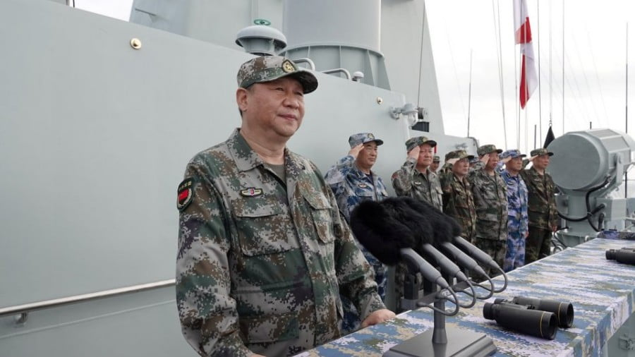 Chinese President Xi Jinping reviews a military display of Chinese People's Liberation Army (PLA) Navy in the South China Sea, April 12, 2018. Picture: Li Gang/Xinhua via Reuters