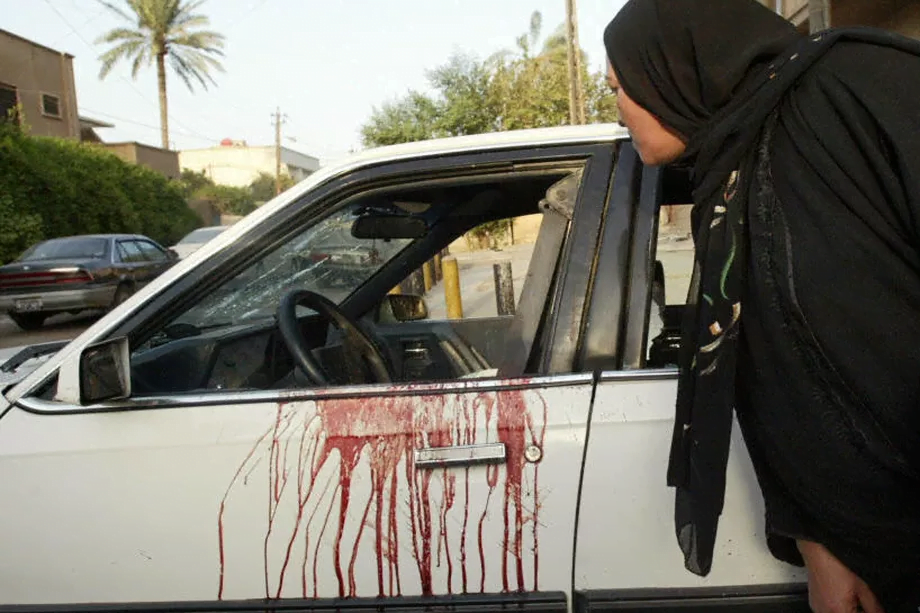 Damaged and bloodied car in Nissour Square, Iraq, 2007 after the Blackwater massacre (AFP/FILE)