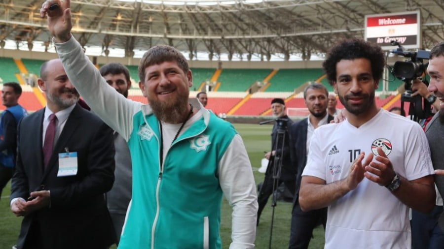 Chechen leader Ramzan Kadyrov, left, waves while standing by Egyptian football star Mohamed Salah, right, during a training run for the Egyptian team at the Akhmat Arena in Grozny on June 10, ahead of the Russia 2018 World Cup. Photo: AFP/ Karim Jaafar