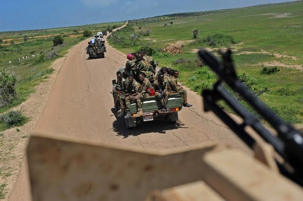 Somali soldiers patrol in a convoy south of Mogadishu on 13 June 2018 (AFP)