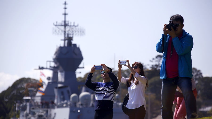 Chinese tourists in front of an Australian naval ship, Sydney, Australia © David Gray / Reuters