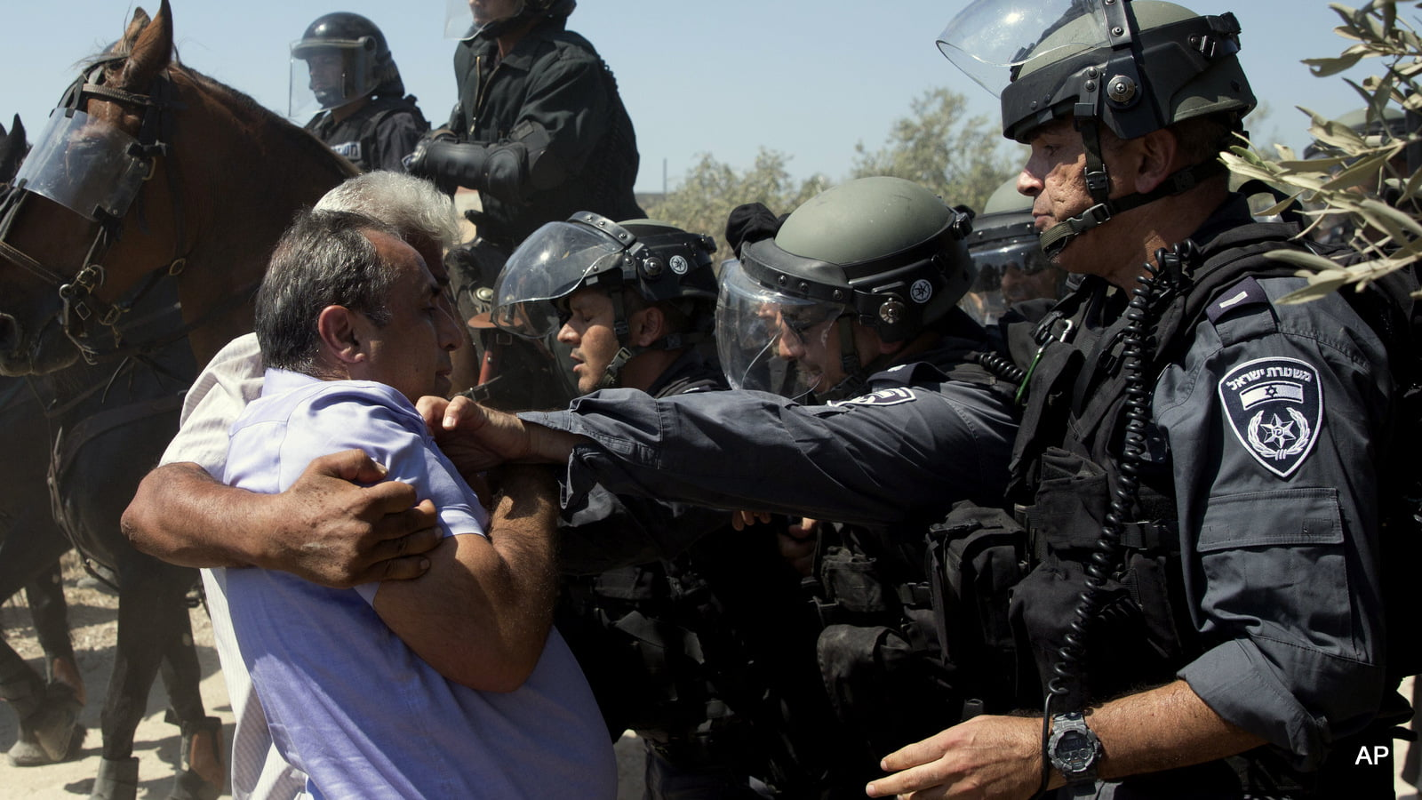 Israeli riot policescuffle with Arab men during a protest in Arab village of Ara, northern Israel, Sept. 19, 2016. AP Photo
