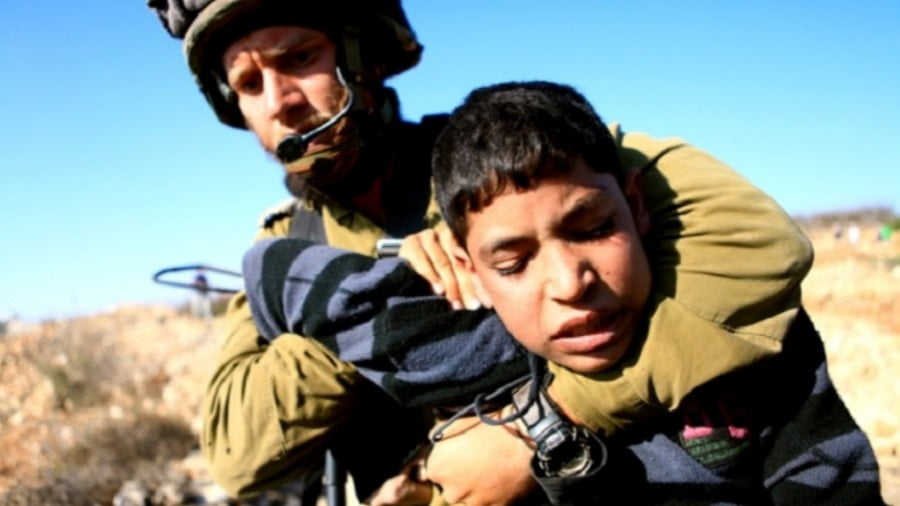 An Israeli occupation soldier arresting a Palestinian child in the West Bank village of Beit Omar. (Photo: Anne Paq, ActiveStills.org)