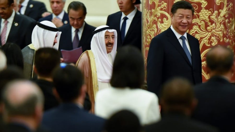 China's President Xi Jinping, right, and Kuwaiti Emir Sheikh Sabah al-Ahmad al-Jaber al-Sabah, center, arrive for the 8th Ministerial Meeting of China-Arab States Cooperation Forum at the Great Hall of the People in Beijing on Wednesday. Photo: AFP/ Wang Zhao