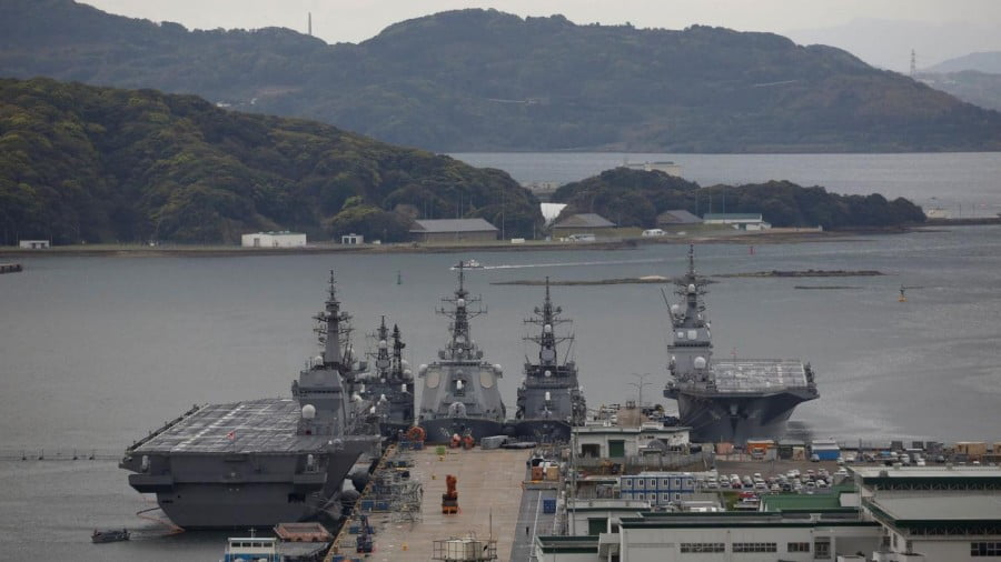 Japan Maritime Self-Defense Force's (JMSDF) latest Izumo-class helicopter carrier DDH-184 Kaga (L) and other JMSDF destroyers DD-157 Sawagari, DDG-176 Chokai, DD-104 Kirisame and DDH-182 Ise are moored at a naval base in Sasebo, on the southwest island of Kyushu, Japan April 6, 2018. REUTERS/Issei Kato