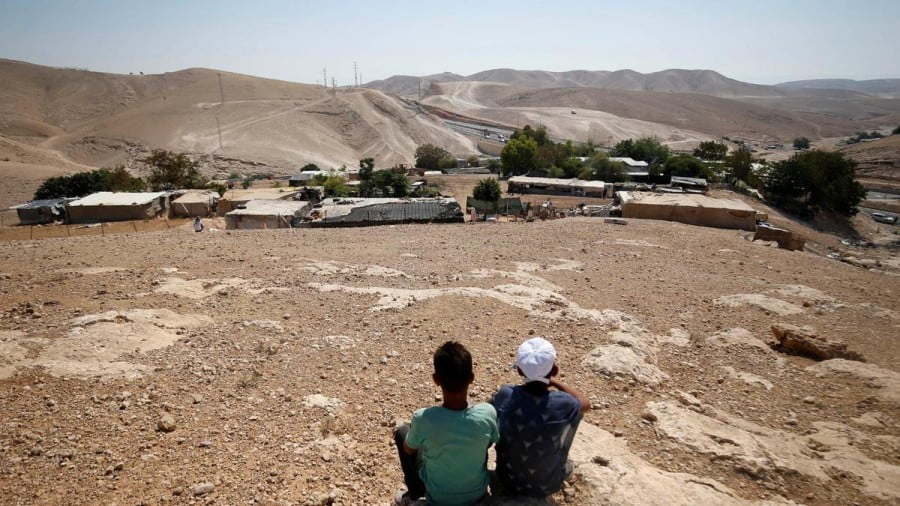 Palestinian boys sit in the Bedouin village of Khan Al Ahmar near Jericho in the occupied West Bank. Mohamad Torokman / Reuters