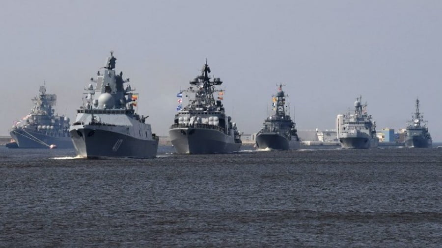 Russian warships, among them the frigate Admiral Gorshkov (second left), sail near Kronshtadt naval base outside St Petersburg on July 20, 2018, during a rehearsal for the Naval Parade. Photo: AFP / Olga Maltseva