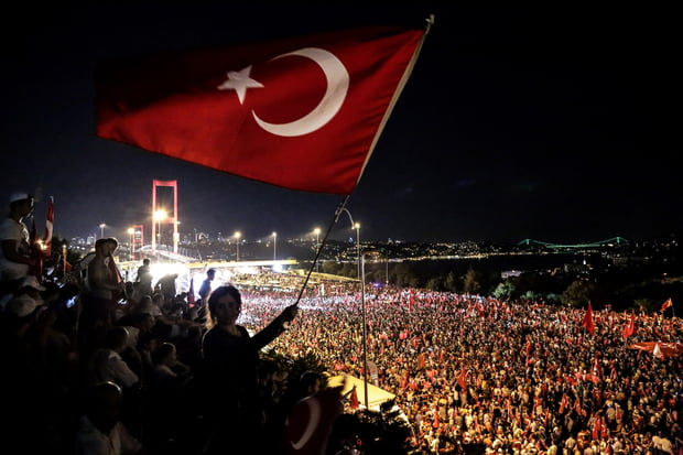 Pro-democracy supporters wave a Turkish national flag during an anti-coup rally in Istanbul on 21 July 2016 (AFP)