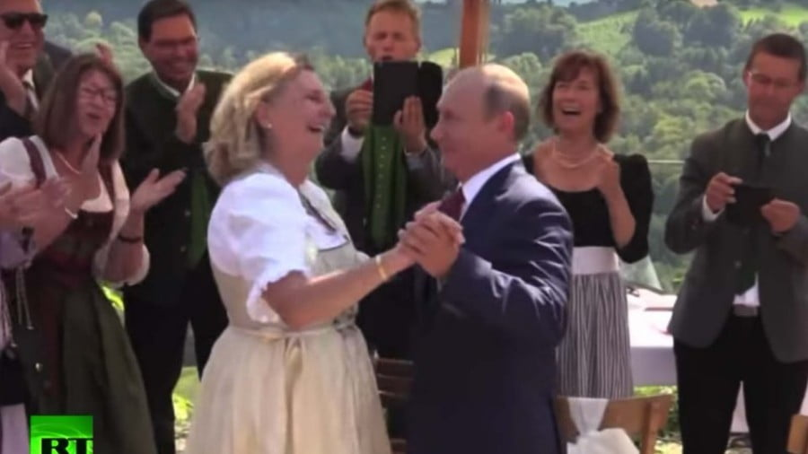 Putin's Wedding Trip Seals Marriage of Convenience with Merkel