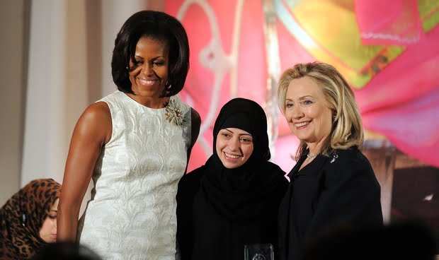 Michelle Obama (L) and Hillary Clinton (R) pose with Saudi activist Samar Badawi as she receives the 2012 International Women of Courage Award (AFP)