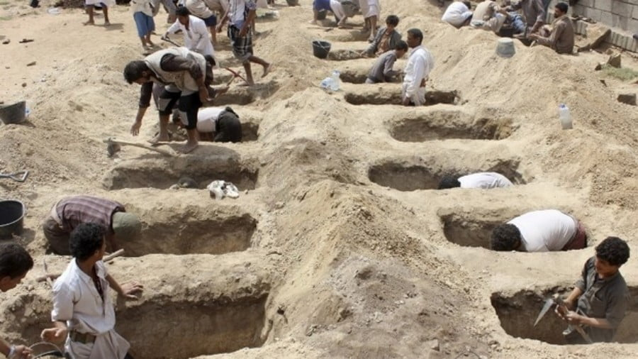 Yemenis dig graves for children, who where killed when their bus was hit during a Saudi-led coalition air strike, that targeted the Dahyan market the previous day in the Huthi rebels' stronghold province of Saada on 10 August , 2018 (AFP)
