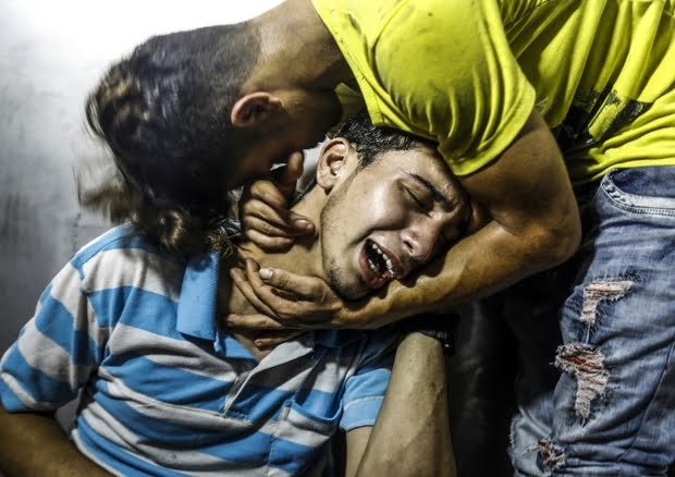 Palestinian youths mourn at al-Shifa hospital in the Gaza Strip in July after two teenagers were killed in an Israeli raid (AFP)
