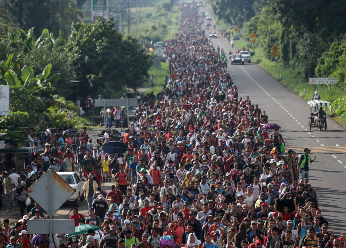 Thousands of migrants from Central America walk toward Tapachula from Ciudad Hidalgo, Mexico, en route to the U.S. on October 21. One of the caravan's organizers estimated the group had swelled to more than 5,000.