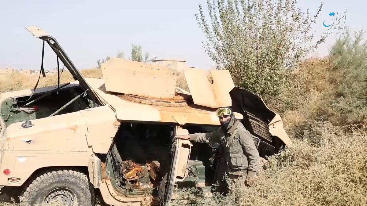 ISIS posting in front of US-made vehicles captured from the Kurds in Baghuz and Sousah.