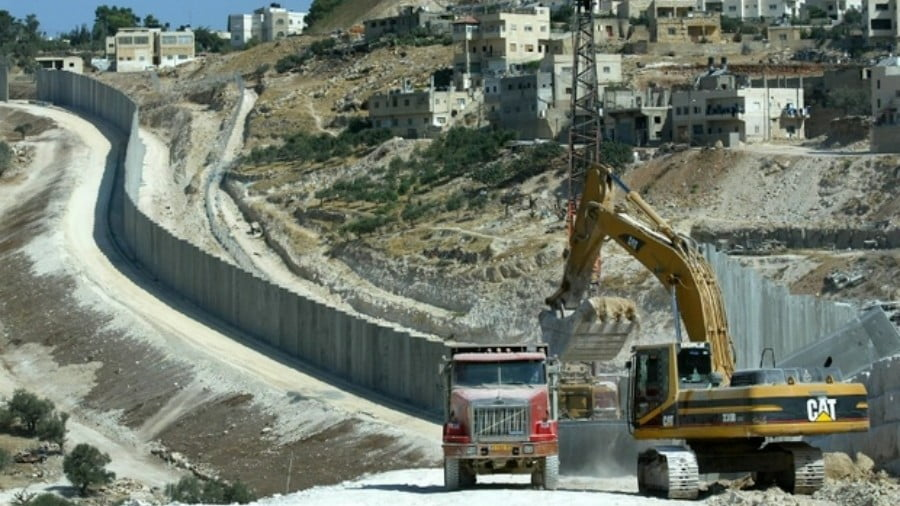 Israeli bulldozers work on the separation wall in 2004 (AFP)