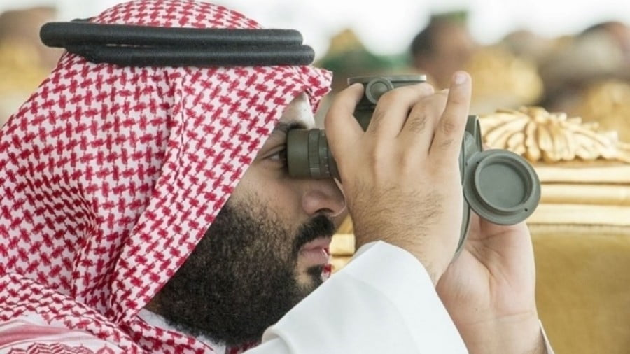 Mohammed bin Salman watches military drills in the eastern Saudi region of Dhahran during the 29th Arab League summit in April 2018 (AFP)