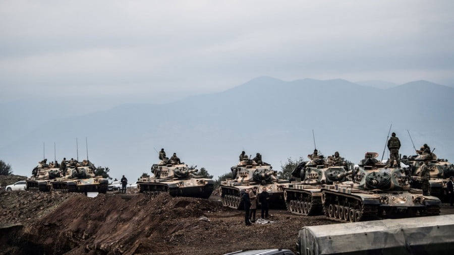 Turkish army tanks wait near the border waiting to cross over into northern Syria, Hassa, Turkey, Jan. 21, 2018. (c) BULENT KILIC/AFP/Getty Images