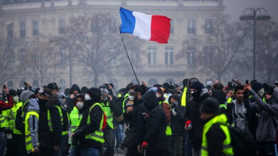Demonstrators gather near the Arc de Triomphe in Paris during a protest on Saturday. Credit: AFP/Getty images