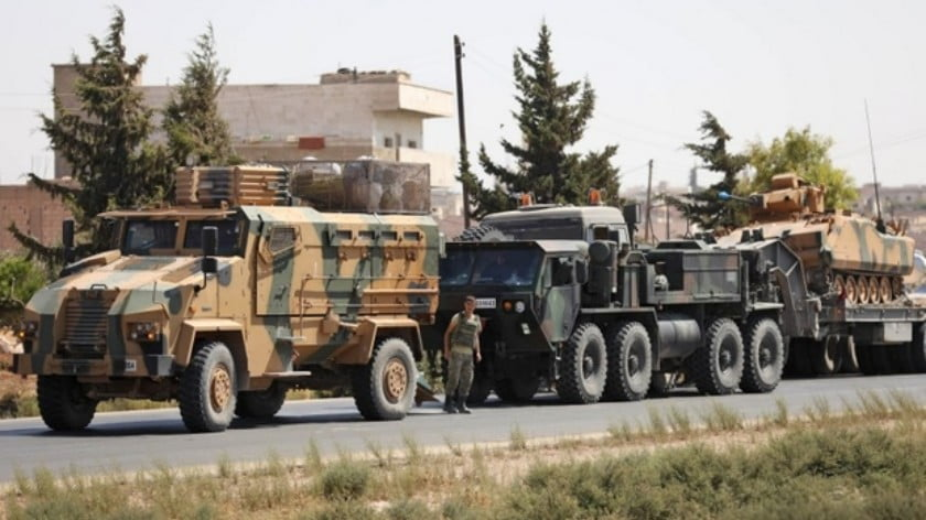 Turkish forces are seen in a convoy near the northern Syrian town of Saraqib on 29 August (AFP)