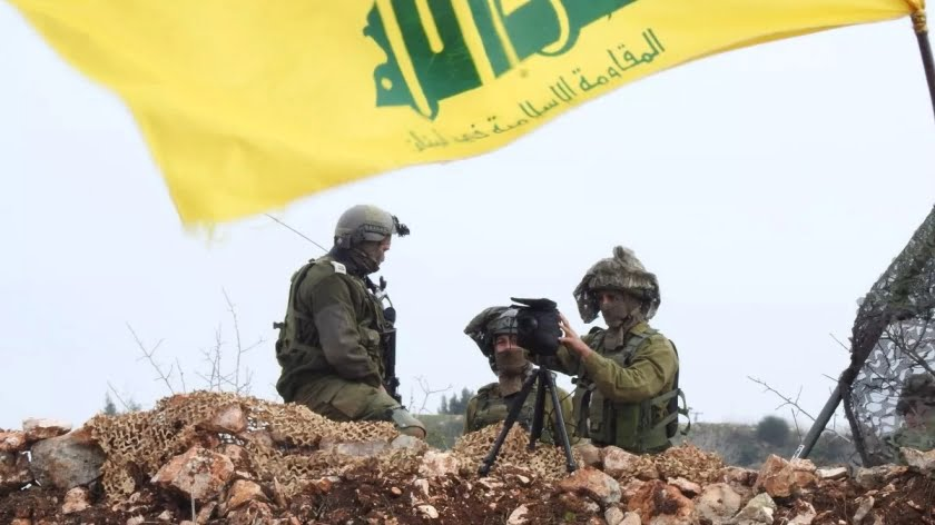 Israeli officers under Hezbollah flags, few meters away from the Lebanese borders