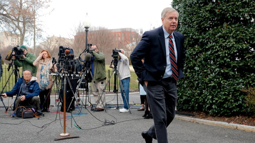 Sen. Lindsey Graham, R-S.C., walks away after speaking to members of the media outside the West Wing of the White House in Washington, after his meeting with President Donald Trump, Dec. 30, 2018. Pablo Martinez Monsivais | AP