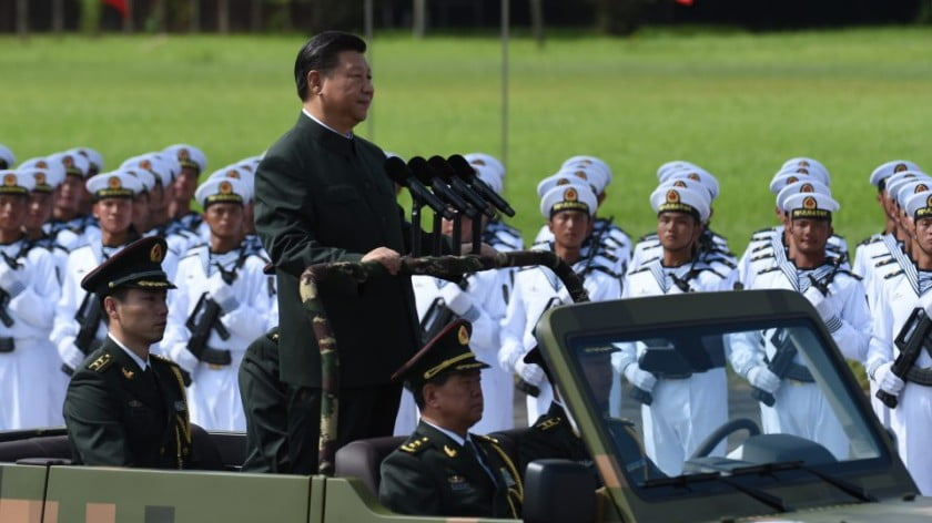 Chinese President Xi Jinping reviews troops from a car during a military parade in Hong Kong on June 30, 2017. China's status in the world has changed under Xi and he's only just getting started. Photo: AFP/Anthony Wallace