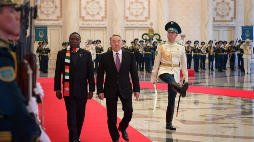 President of Zimbabwe Emmerson Mnangagwa, left, gets an honor guard after meeting Kazakhstan President Nursultan Nazarbayev during his visit to Astana on Monday. Photo: AFP / Kazakhstan Presidency / Anadolu